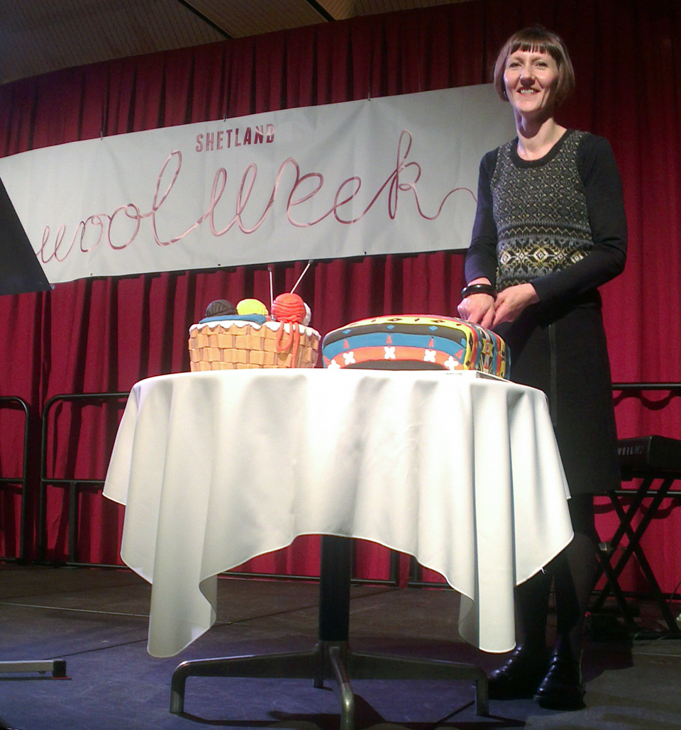 Donna Smith, patron for Shetland Wool Week 2015, cutting the cake at the opening ceremony