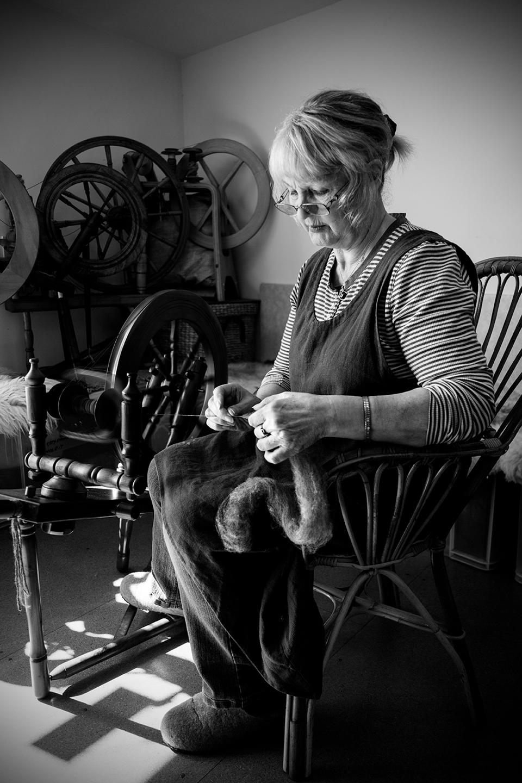 Elizabeth Johnston hand-spinning yarn on a beautiful old Shetland wheel