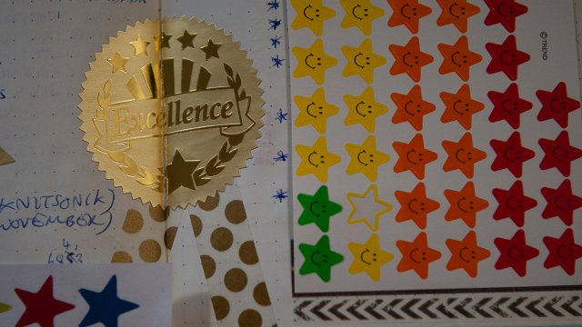 A very fun sheet of stickers with a massive golden EXCELLENCE seal in the middle of it