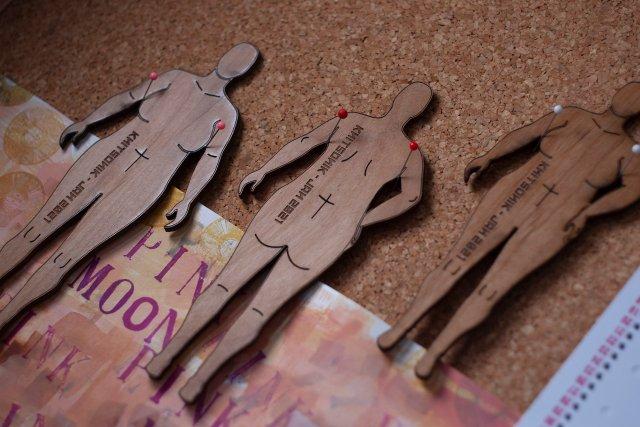 wooden mini-mes on the corkboard in my studio