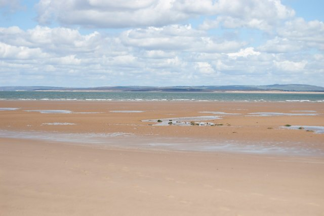 Looking out across Broughton Bay - little pools of wet sand, and a rolling vista of clouds up ahead... blue water reflecting the sky above stretches out, there are acres of sand and sky