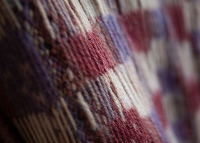 intriguing strands on the back of a piece of stranded colourwork knitwear.