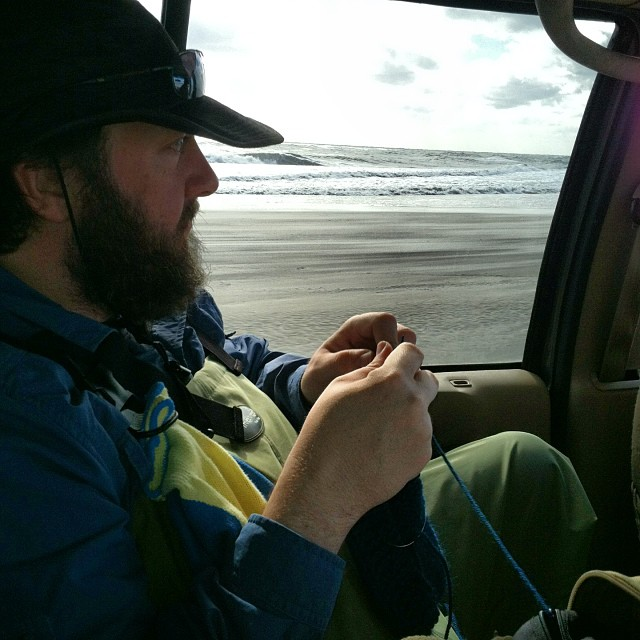 Knitting Daddy Greg knitting the fishcloth dishcloth while driving down the coast before fishing for the day.