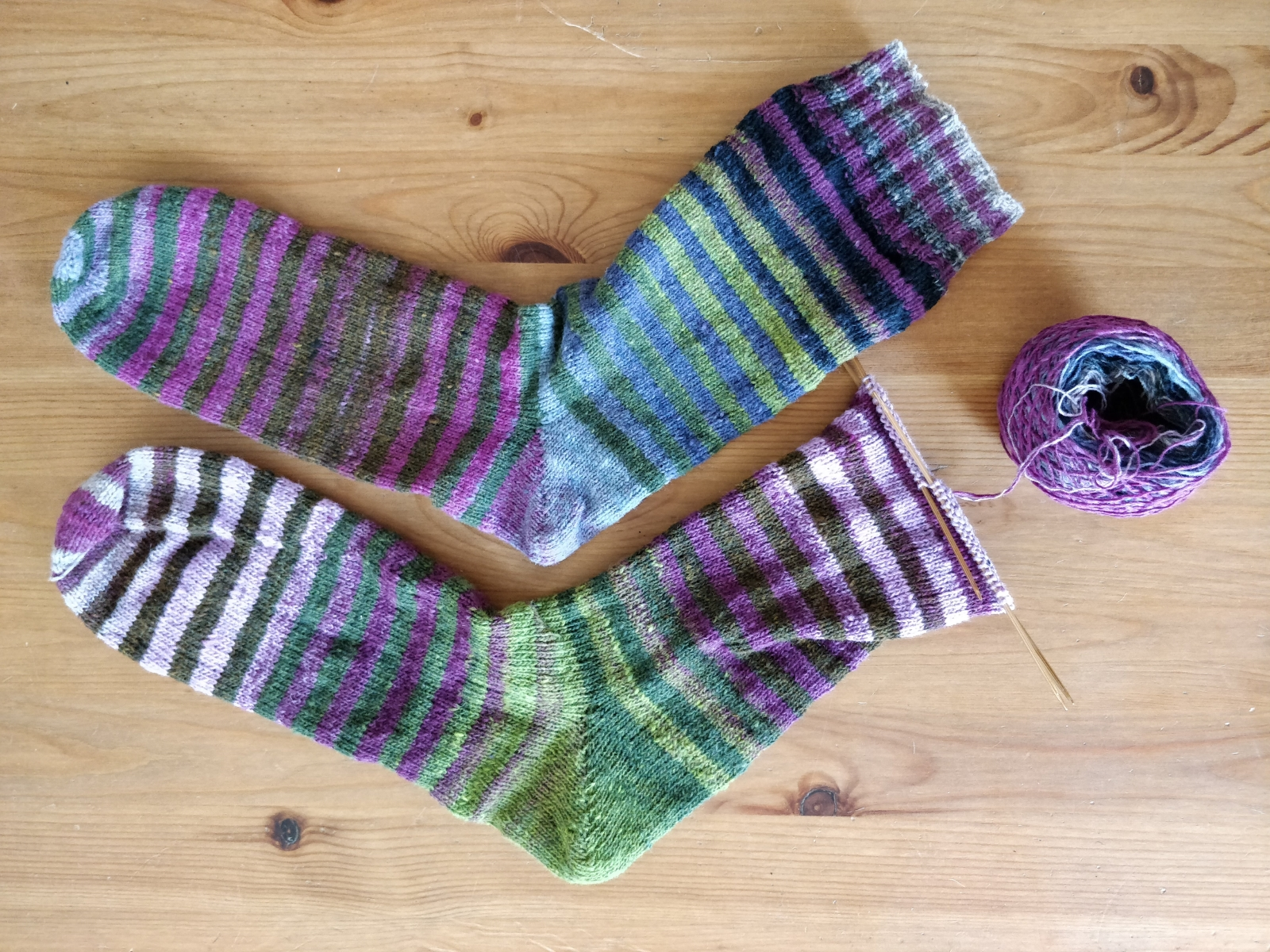 Two stripey socks, one of them finished, one of them almost finished and still on the needles.
