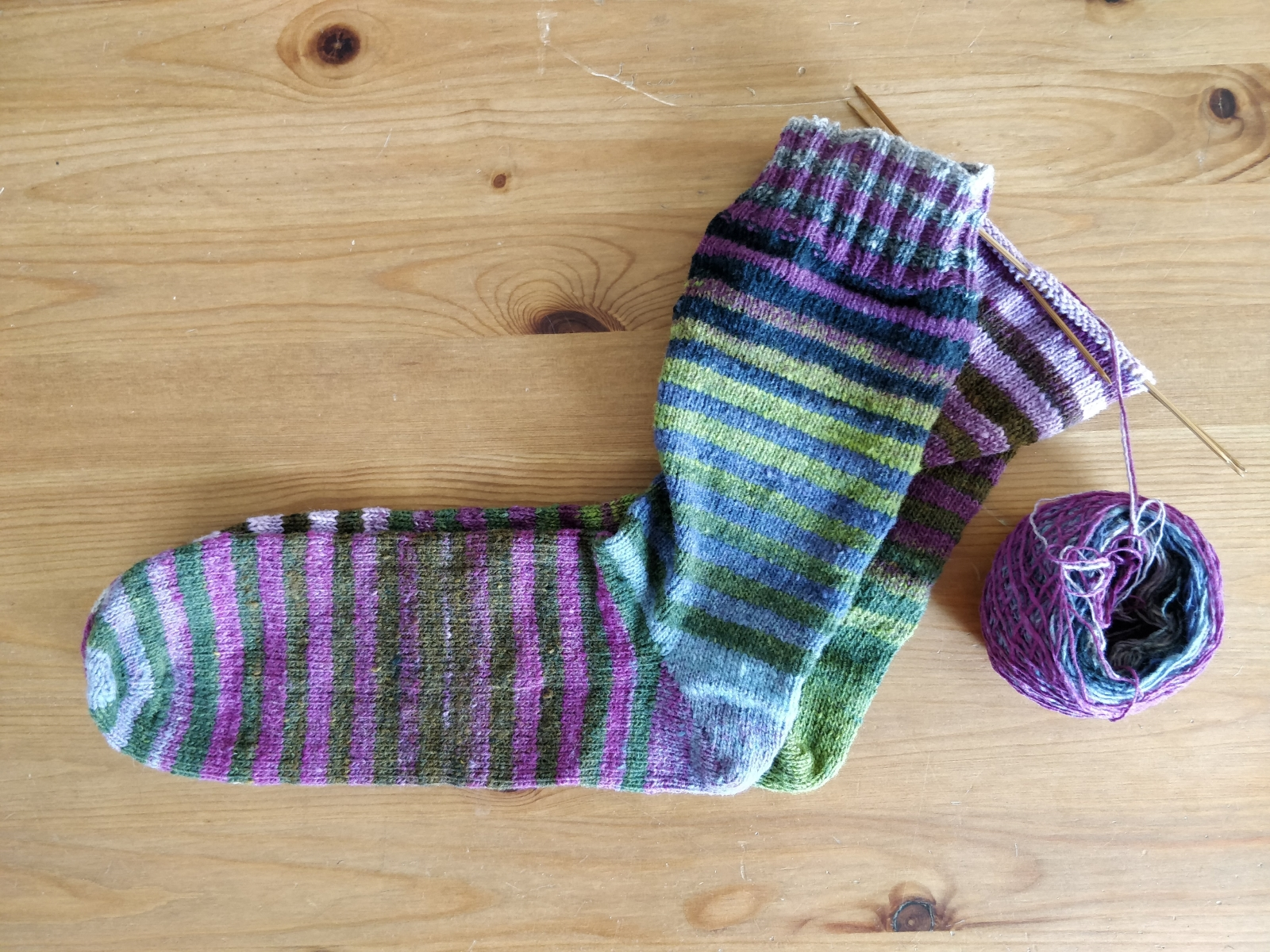 Two differently sized striped socks.