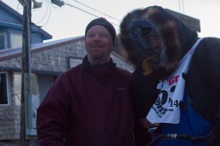 Sharing a moment with fellow musher, Aaron Burmeister.