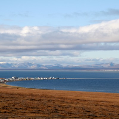 The community of Teller is in the foreground, with Brevig Mission faintly visible across the water. Photo: KNOM File.