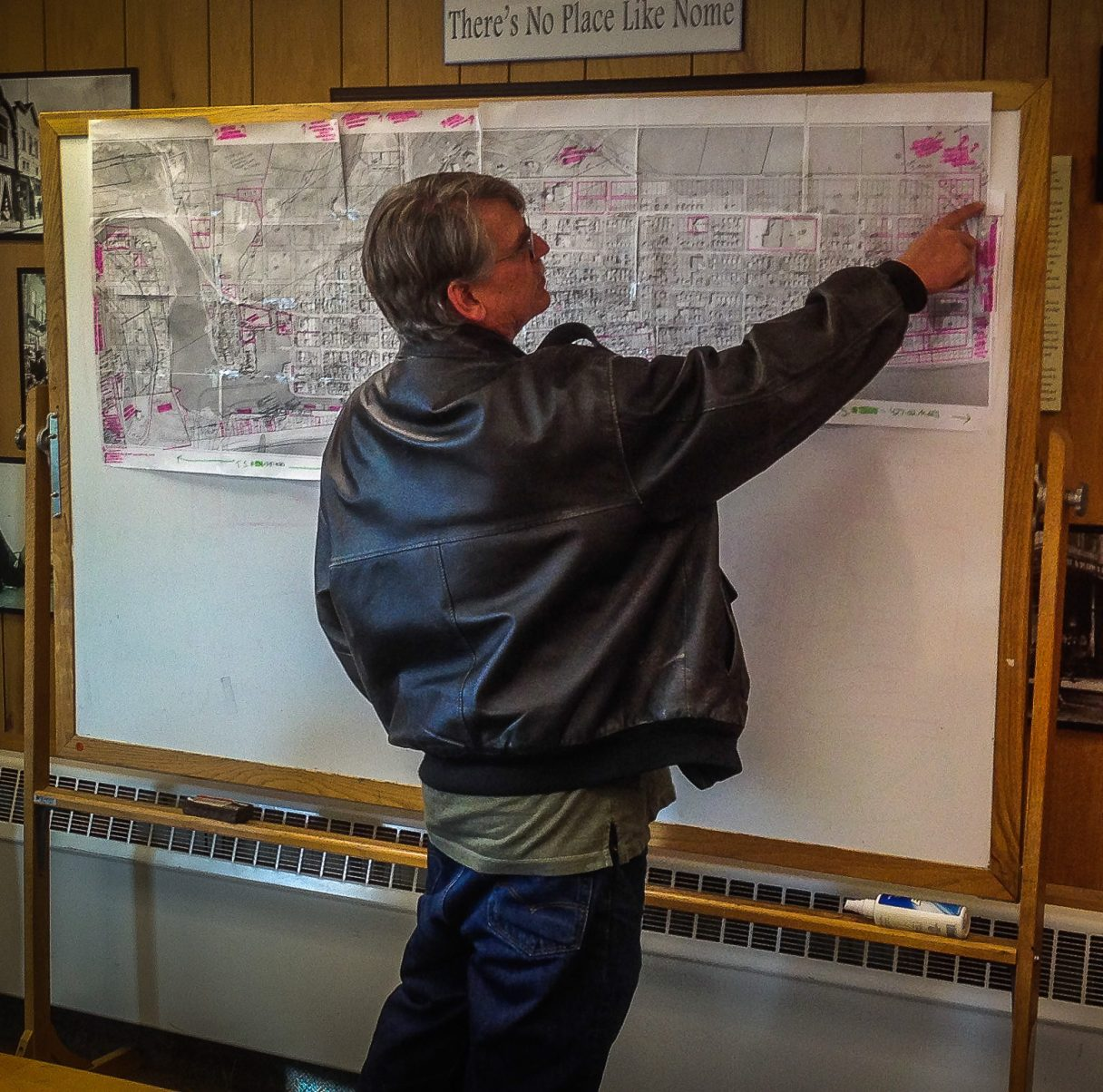 Nome City Council member Jerald Brown points to an area of land on the zoning map. Photo: Matthew F. Smith, KNOM.