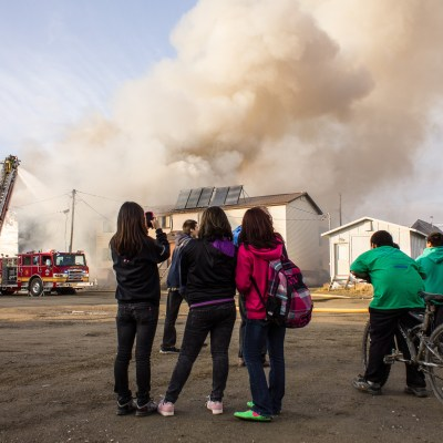 Onlookers and the East 3rd Avenue fire in Nome