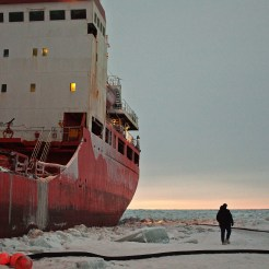 January 2012: at dusk, before walking back to shore, KNOM's Matthew Smith takes a final look at the Russian tanker Renda. Photo: David Dodman, KNOM.