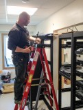 Nome electrician Pat Knodel installs a 220-volt power outlet in one of the new equipment racks for KNOM's soon-to-be-completed digital studios annex. Photo: Ric Schmidt, KNOM.