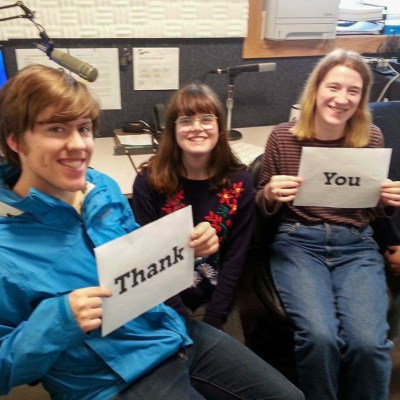 "In our now-operational digital studios, a special ""Thank You"" from 2016-2017 KNOM volunteers Tyler, Lauren, Karen, and Davis. Photo: Margaret DeMaioribus, KNOM."