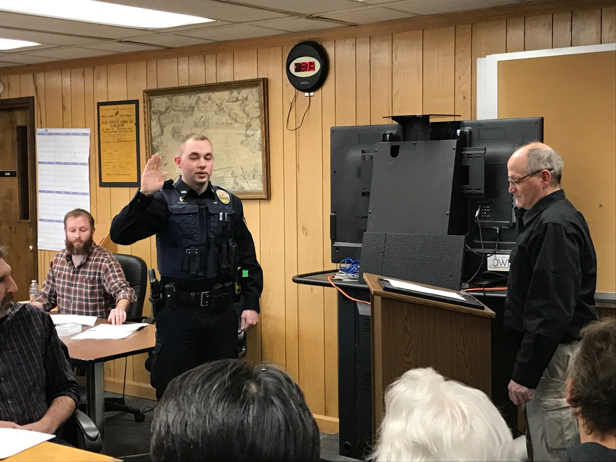 Wade Harrison takes the oath to become a Nome police officer. Nome City Council meeting, Monday, April 10, 2017.