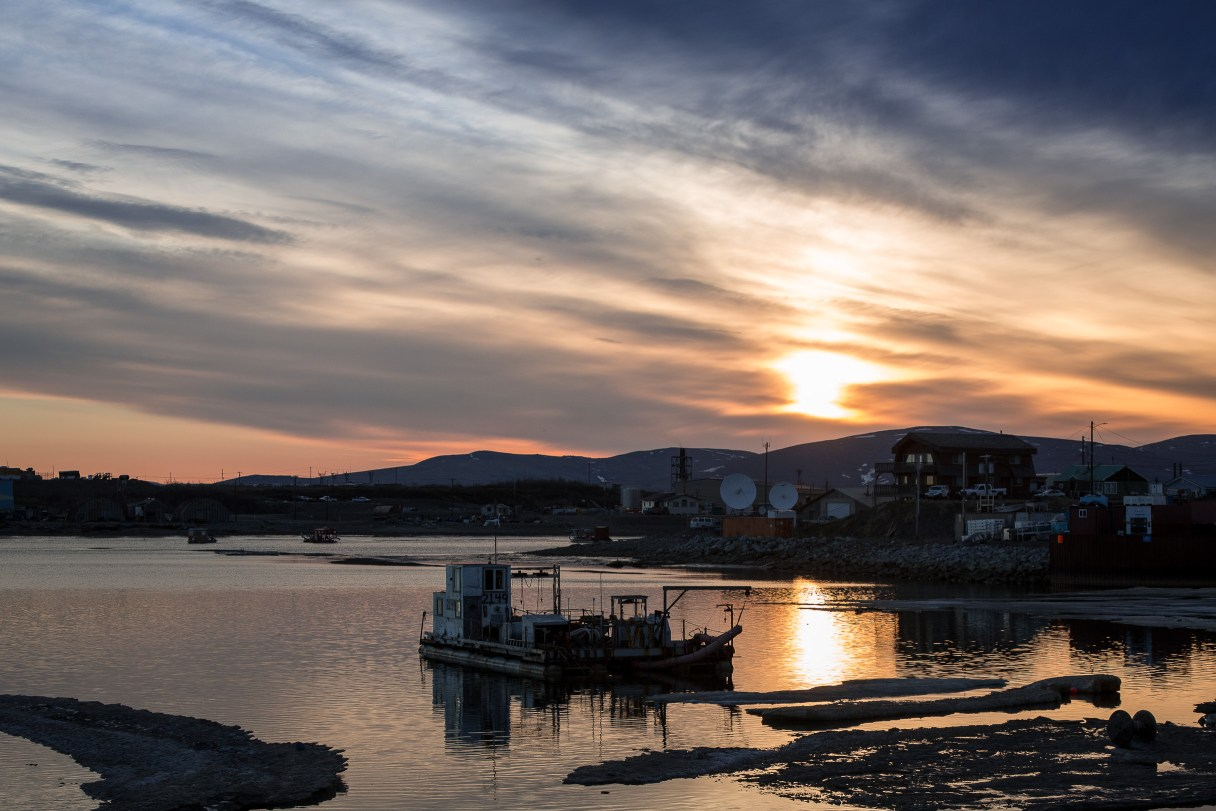 The sun hangs low over the Nome port, past midnight on a June evening.