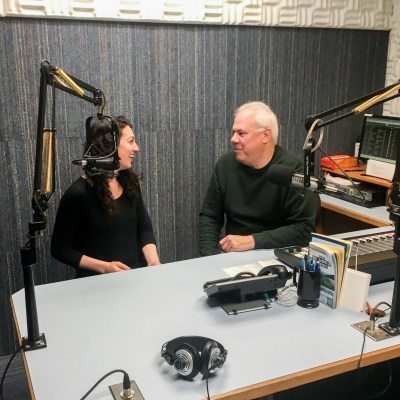 Margaret and Ric chat inside a radio studio