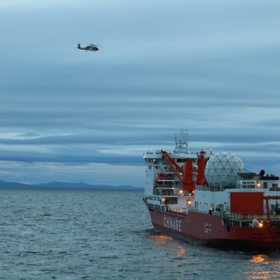 A small boat crew from the Coast Guard Cutter Alex Haley medevacs a man suffering a broken arm from the Chinese research vessel Xue Long, 15 nautical miles from Nome, Alaska, Sept. 23, 2017. U.S. Coast Guard photo.