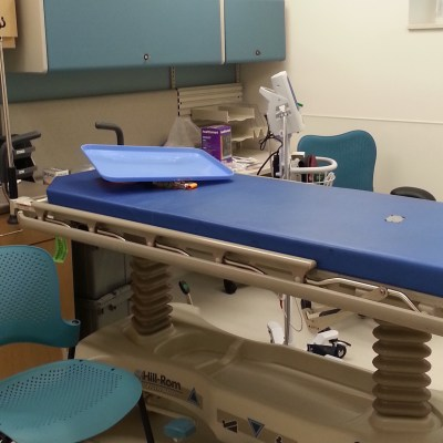 A blue and white medical exam room in the new Gambell clinic.