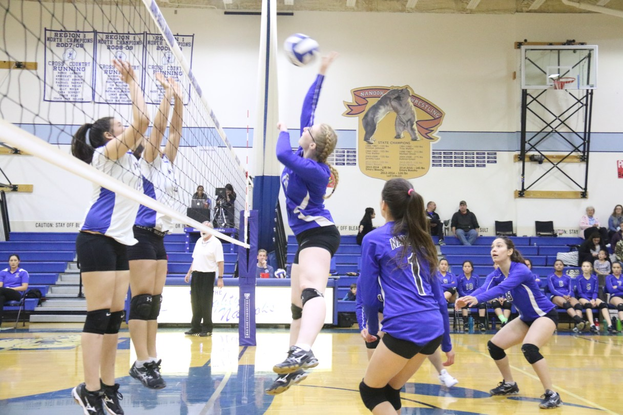 A Nome-Beltz player spikes the ball at a home game against Kotzebue