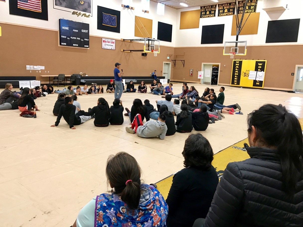 Students at the 2017 BSSD Youth Leaders retreat sit in a circle on the floor of the Unalakleet school gym to tell stories.
