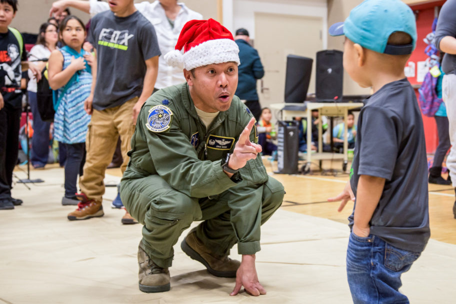 The children of St. Michael visit with volunteers and Alaska National Guard members during Operation Santa Claus.