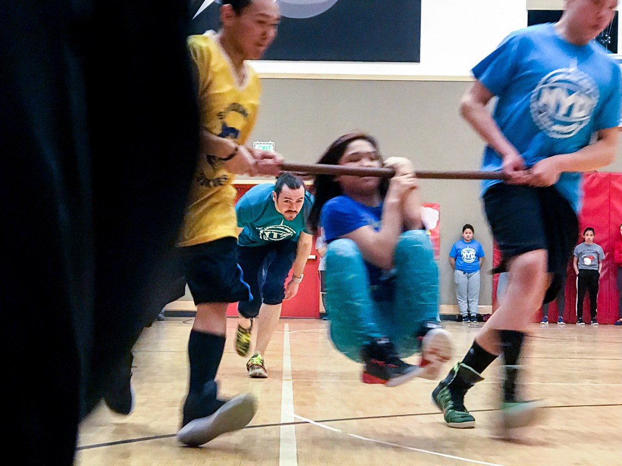 Wrist-carry competitors race at the 2018 BSSD NYO tournament in St. Michael, Alaska.