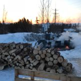Steam rises from the barrels of water kept hot over fires for mushers on the Kobuk 440.