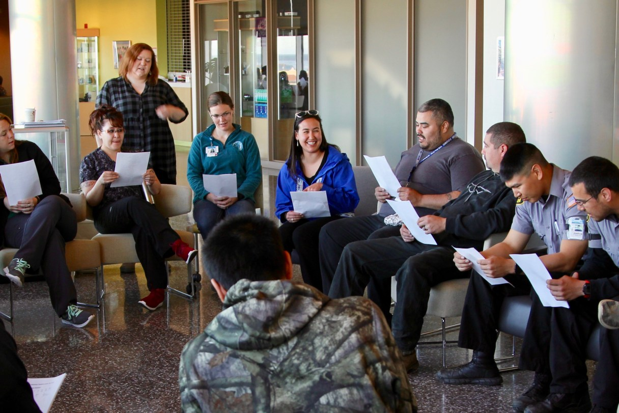 People sit in a group learning Iñupiaq sounds at Norton Sound Regional Hospital