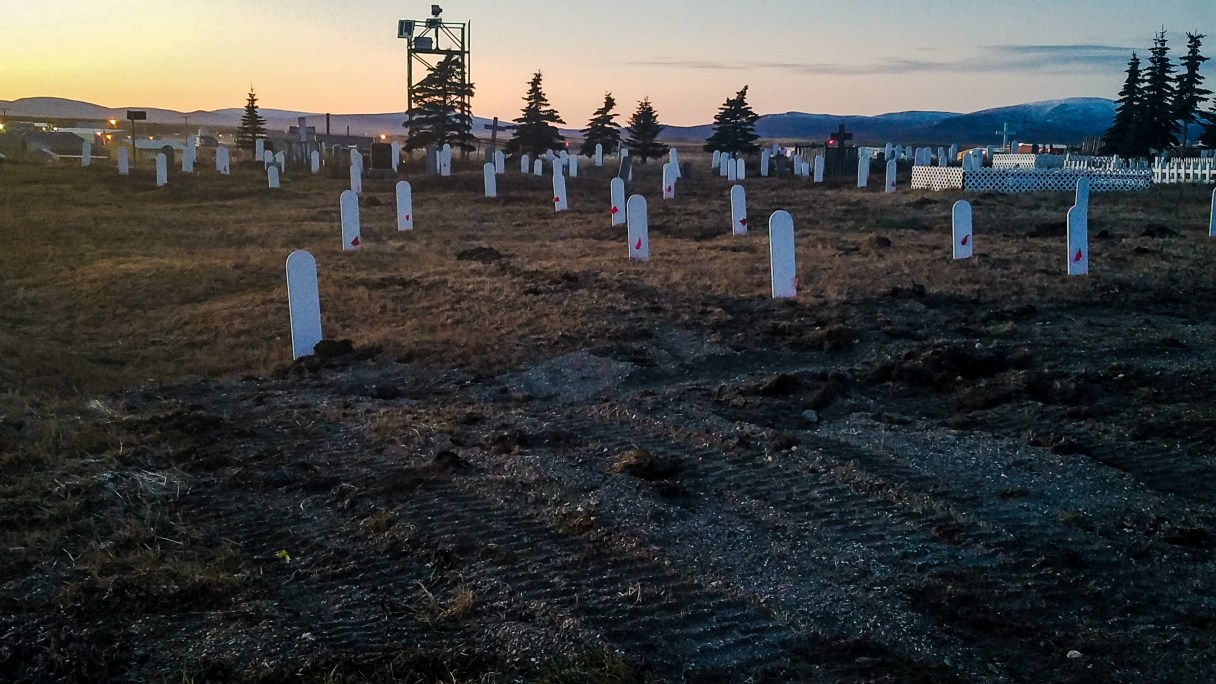 Landscape view of plain white grave markers at the Nome cemetery.