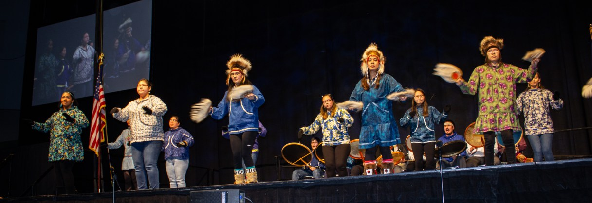 Alaska Native student group dancing.