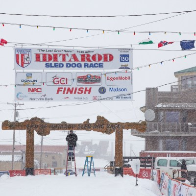 The burled arch in Nome being prepared for the Iditarod finish.