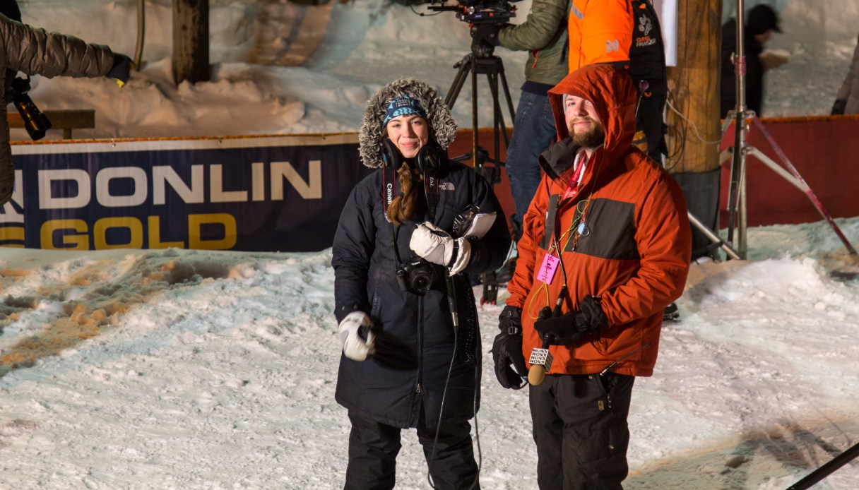 Two reporters with KNOM Radio, Emily Hofstaedter and Davis Hovey, waiting for the first Iditarod finisher.