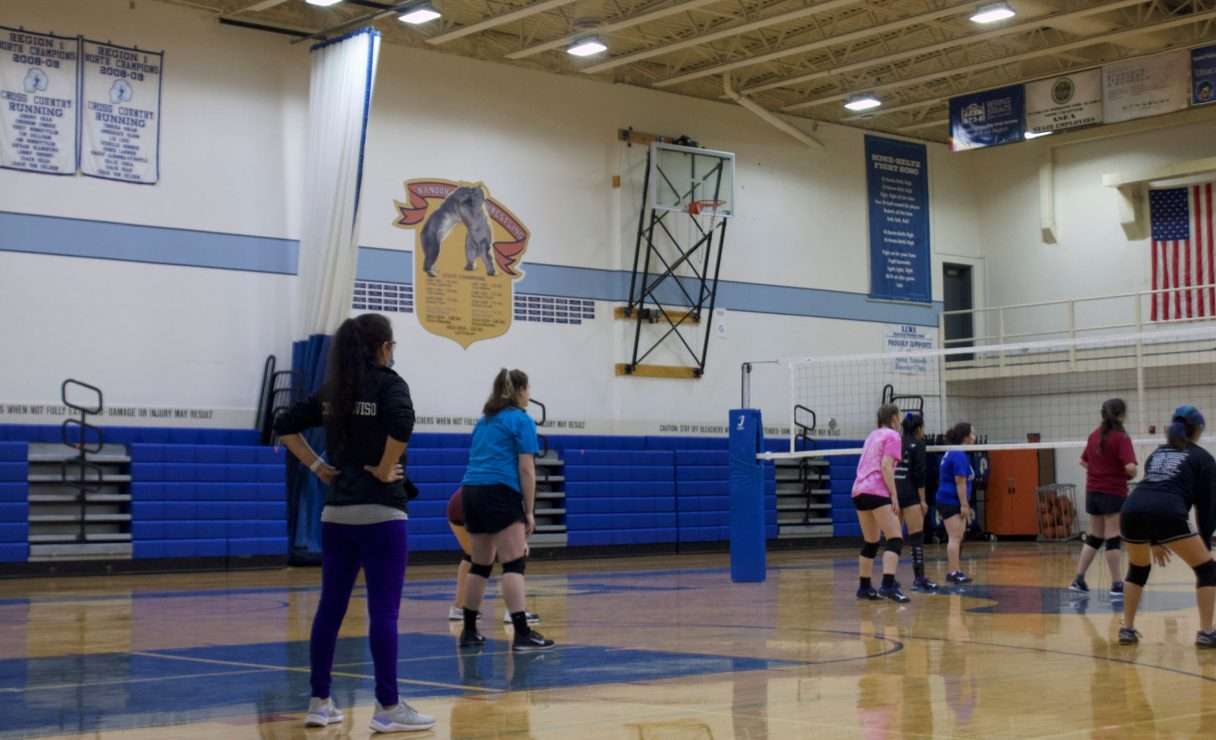 NBHS volleyball coach, Veronica Alviso, observes her team's practice in September, 2020. (Photo from Sophia DeSalvo, KNOM 2020)