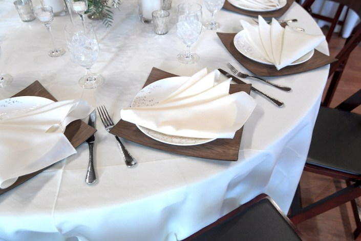 Place setting with wooden charger