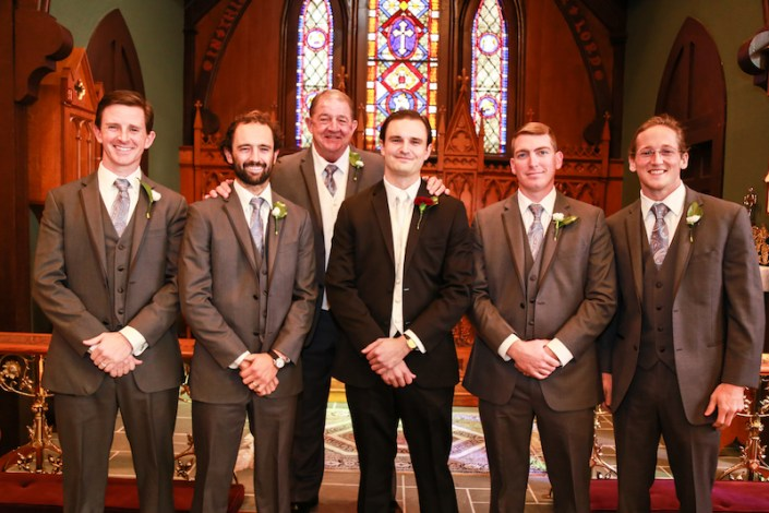 Groom with groomsmen in church