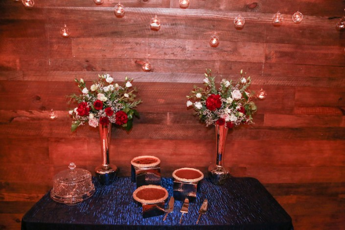 Dessert table decor of elevated arrangements and hanging candles
