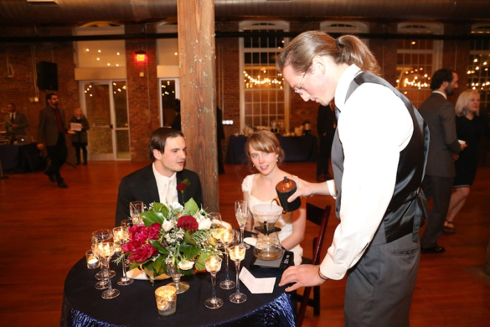 Bride & groom at sweetheart table getting coffee service