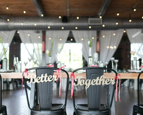 Head table with bride and groom chairs