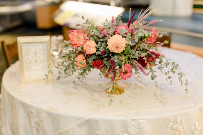 sweetheart table centerpiece in a gold compote