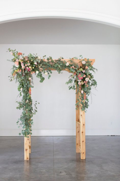 ceremony-arbor-flowers-summer-wedding