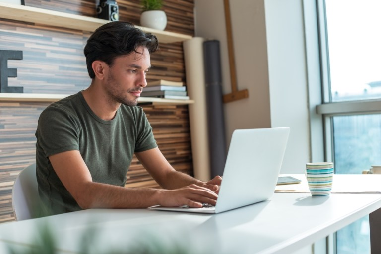 Optimized-Young-man-working-on-laptop-614959164_6461x4312 (1)