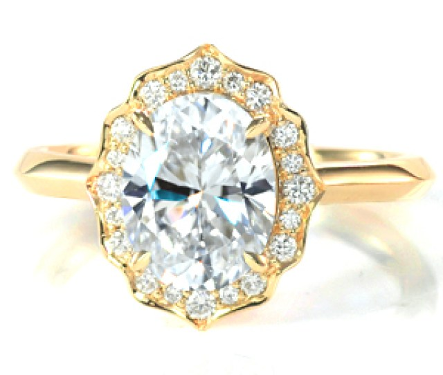 Shown With A   Carat Oval Cut Diamond This Majestic Engagement Ring Features A Scalloped