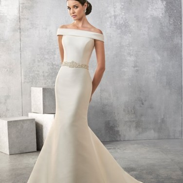 AMANDA 2017 COLLECTION A classic looking bateau neck Mikado slim fitting gown with beaded waistband, low back and button detail