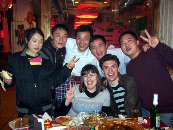 Myself (center left) and a friend (center) at a company dinner party in Beijing for Lunar New Year 2009