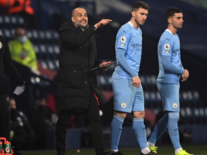 Pep Guardiola calm after City take lead in 'incredible marathon' of Premier League