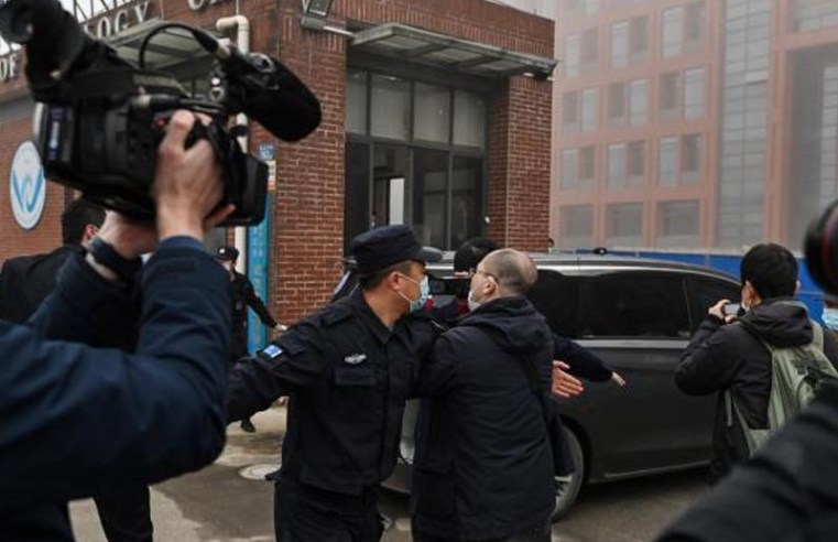 WHO team visits Wuhan lab as Russian vaccine boosts hopes