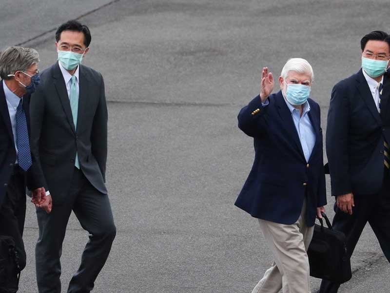 US diplomats arrive in Taipei after China warns Washington to keep out of Beijing's internal affairs