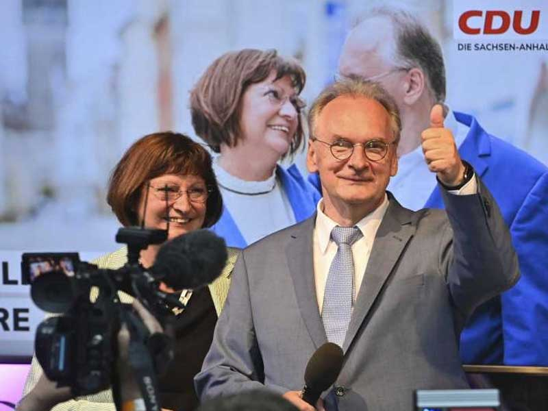 Merkel's party fends off far-right challenge in state vote