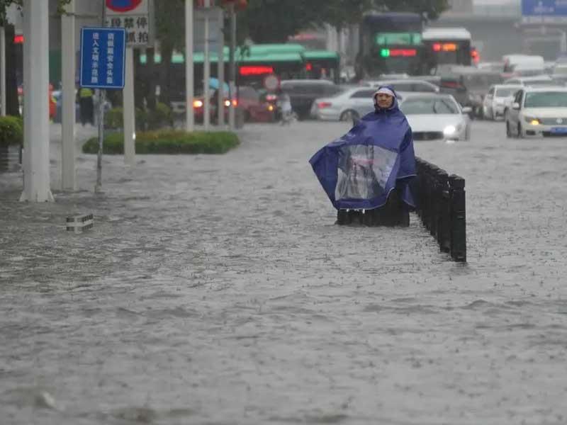 China evacuates residents from flooded neighborhoods