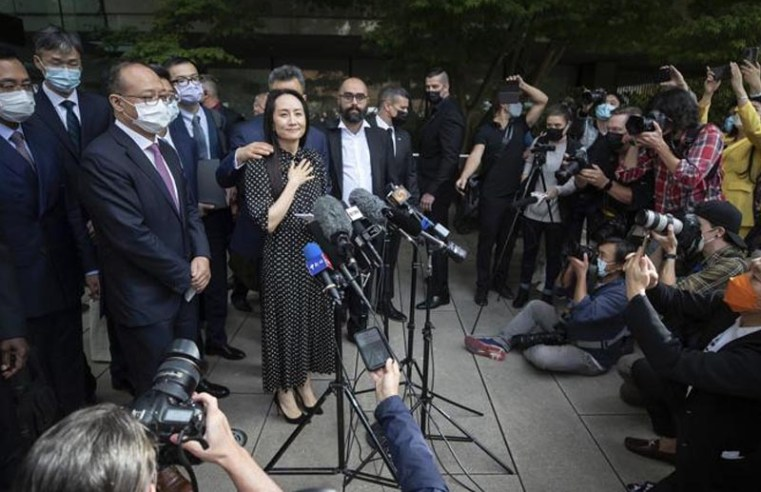 Huawei executive returning as China releases Canadians