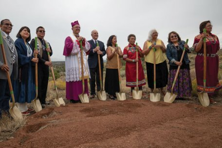 Bishop James S. Wall of Gallup, Father Maurice Henry Sands, Supreme Knight Carl A. Anderson and members of the Pueblo of Laguna, N.M., break ground on the St. Kateri Tekakwitha Shrine in Gallup, Aug. 11. Photo by Phillip Flores.